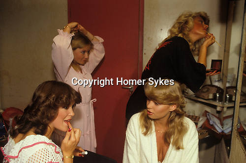 Camberley, Surrey. 1980's<br /> With their Farrah Fawcett Baywatch curled locks, Miss Camberley beauty competition contestants in their dressing room make last minute adjustment to their special look.<br /> .