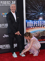 Roland Emmerich + Joey King @ the premiere of 'Independence Day: Resurgence' held @ the Chinese theatre.<br /> June 20, 2016.