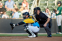 Rapidos de Kannapolis catcher Michael Hickman (37) sets a target as home plate umpire Tanner Moore looks on during the game against the Greensboro Grasshoppers at Kannapolis Intimidators Stadium on June 14, 2019 in Kannapolis, North Carolina. The Grasshoppers defeated the Rapidos de Kannapolis 4-1. (Brian Westerholt/Four Seam Images)