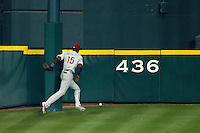 "Philadelphia Phillies outfielder John Mayberry #15 chases a ball hit by JD Martinez around the Minute Maid Park flag pole located on ""Tal's hill"" during the third inning of Major League baseball game against the Houston Astros on September 16th, 2012 in Houston, Texas. Martinez recorded a triple and the Astros defeated the Phillies 7-6. (Andrew Woolley/Four Seam Images)."