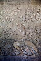 Cambodia, Angkor Wat.  Gods Churning the Sea of Milk, from the Hindu Creation Myth, the Bhagavata-Purana.  Rahu, an asura in disguise among the devas.  12th. Century.