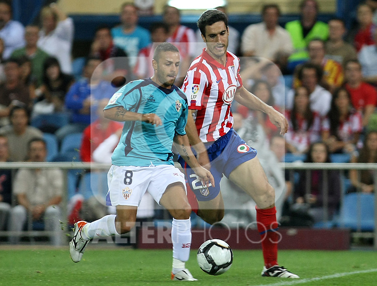 Almeria's Albert Crusat (l) and Atletico de Madrid's Pablo Ibanez during La Liga match. September 24 2009. .(ALTERPHOTOS/Acero).