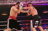 19th December 2020, Hamburg, Germany; Universal Boxing Promotion fight, Felix Sturm versus Timo Rost; Fighters clash in middle of the ring