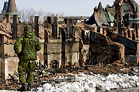 A soldier looks at the Manege Militaire de Quebec (Quebec city armory) ruins on avenue Wilfrid-Laurier April 7, 2008. The fire completely destroyed on April 4 the Manege militaire, an important piece of the Canadian military history built in 1885.