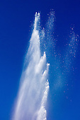 Switzerland. Geyser jet of water fountain against blue sky.