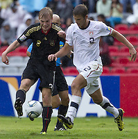 .Action photo of Cimo Roecker (L) of Germany and Zachary Carroll (R) of USA, during game of the FIFA Under 17 World Cup game, held at Queretaro.
