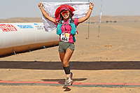 8th October 2021; Boulchrhal to Sud Jebel Irhfelt N'Tissalt ; Marathon des Sables, stage 5 and final stage of a six-day, 251 km ultramarathon, which is approximately the distance of six regular marathons. The longest single stage is 91 km long. This multiday race is held every year in southern Morocco, in the Sahara Desert. Tomomi Bitoh (JPN) celebrates as she wins the 5th Stage of 82.2km