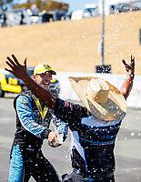 Jul 30, 2017; Sonoma, CA, USA; NHRA pro stock driver Tanner Gray celebrates with crew member after winning the Sonoma Nationals at Sonoma Raceway. Mandatory Credit: Mark J. Rebilas-USA TODAY Sports