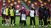 Brentford's Assistant Head Coach, Brian Riemer, speaks  to the players ahead of kick-off during Brentford vs Bristol City, Sky Bet EFL Championship Football at the Brentford Community Stadium on 3rd February 2021