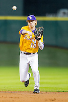 LSU Tigers second baseman Grayson Byrd (10) makes a throw to first base during the Houston College Classic against the Nebraska Cornhuskers on March 8, 2015 at Minute Maid Park in Houston, Texas. LSU defeated Nebraska 4-2. (Andrew Woolley/Four Seam Images)