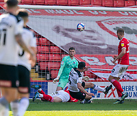 24th April 2021, Oakwell Stadium, Barnsley, Yorkshire, England; English Football League Championship Football, Barnsley FC versus Rotherham United; Richard Wood of Rotherham chance blocked by Callum Styles of Barnsley