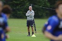 QPR assistant Joe Jordan watch the first team train
