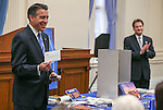 Lt. Gov. Brian Krolicki, right, listens as Gov. Brian Sandoval speaks at a ceremony to place items in the NV150 time capsule at the Capitol, in Carson City, Nev., on Monday, Dec. 15, 2014.  The capsule, containing 45 items related to the Sesquicentennial, is set to be opened in 2064.<br /> Photo by Cathleen Allison