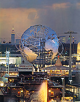 View of the 1964 World's Fair in New York at dusk with the Unisphere and the Empire State Building. Taken from atop the Fair's Better Living Pavillion. Photo by John G. Zimmerman.