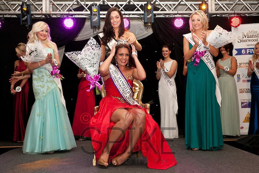 Winner of Miss Mansfield 2012-13 Alice Kurylo receives her tiara from last year's winner Alicia Caley