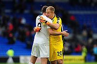 ,<br /> Sam Vokes and Joe Hart of Burnley celebrate at full time of the Premier League match between Cardiff City and Burnley at Cardiff City Stadium in Cardiff, Wales, UK. Sunday 30 September 2018