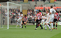 Pictured: Ashley Williams of Swansea (L) sees that the ball enters the nets of Sheffield United from a free kick by team mate Stephen Dobbie (not pictured). Saturday 07 May 2011<br /> Re: Swansea City FC v Sheffield United, npower Championship at the Liberty Stadium, Swansea, south Wales.