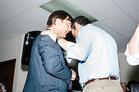 Texas senator and Republican presidential candidate Ted Cruz speaks a campaign worker after speaking to a crowd at the kick-off event at his New Hampshire campaign headquarters in Manchester, New Hampshire.