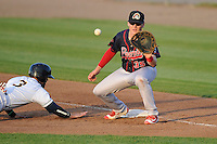 Peoria Chiefs R.J. Dennard (35) waits for the throw as Burlington's Jordan Serena (3) slides back into first base during the game against the Burlington Bees at Community Field on June 9, 2016 in Burlington, Iowa.  Peoria won 6-4.  (Dennis Hubbard/Four Seam Images)