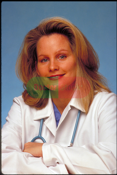 portrait of smiling doctor wearing lab coat