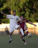 Boston College forward/midfielder Amit Aburmad (7) and Harvard University defender Eric Slingerland (26) battle for the ball. Boston College defeated Harvard University, 2-0, at Newton Campus Field, October 11, 2011.