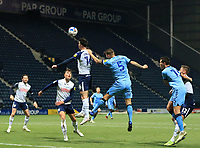 29th December 2020; Deepdale Stadium, Preston, Lancashire, England; English Football League Championship Football, Preston North End versus Coventry City; Andrew Hughes of Preston North End leaps to head a clearance under pressure from Kyle McFadzean of Coventry City
