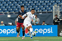 FOXBOROUGH, MA - AUGUST 7: Mateo Rodas #63 of Orlando City B passes the ball as Damian Rivera #72 of New England Revolution II defends during a game between Orlando City B and New England Revolution II at Gillette Stadium on August 7, 2020 in Foxborough, Massachusetts.