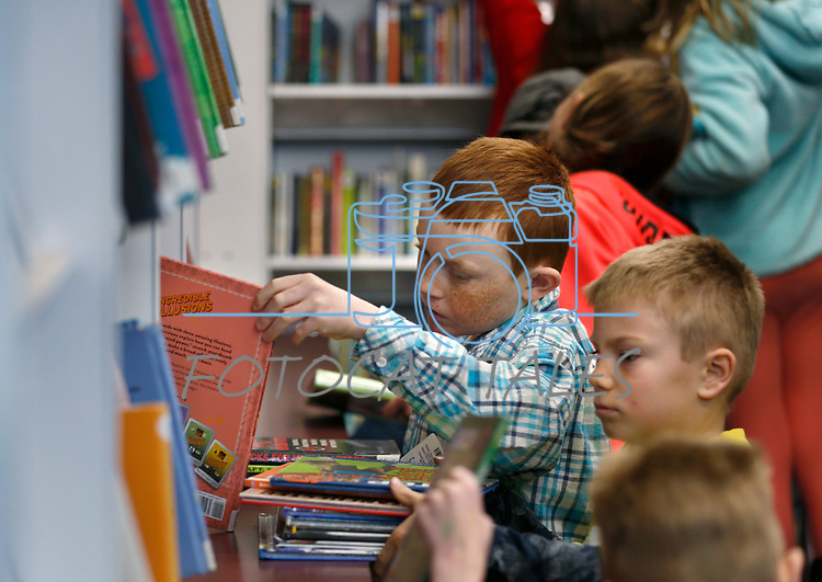 Students select their books from the Elko County Bookmobile during a recent visit to the one-room schoolhouse in Ruby Valley. <br /> Photo by Cathleen Allison/Nevada Momentum