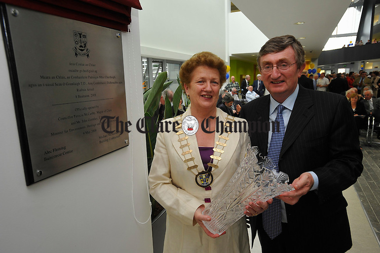 Mayor of Clare Patricia Mc Carthy accepts a presentation from contractor Bernard Mc Namara after she unveils a wall plaque at the official opening of Aras Contae an Chlair. Photograph by John Kelly.