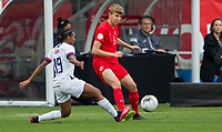 CARSON, CA - FEBRUARY 9: Crystal Dunn #19 of the United States defending against Rebecca Quinn #5 of Canada during a game between Canada and USWNT at Dignity Health Sports Park on February 9, 2020 in Carson, California.
