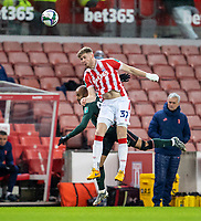 23rd December 2020; Bet365 Stadium, Stoke, Staffordshire, England; English Football League Cup Football, Carabao Cup, Stoke City versus Tottenham Hotspur; Nathan Collins of Stoke City heads the ball clear