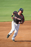 Danny Hayes (32) of the Kannapolis Intimidators hustles towards third base against the Hagerstown Suns at CMC-Northeast Stadium on June 1, 2014 in Kannapolis, North Carolina.  The Suns defeated the Intimidators 11-5 in game two of a double-header.  (Brian Westerholt/Four Seam Images)