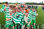 Killarney Celtic team celebrate with the jersey of their late teamate Niall McGillycuddy after winning at the FAI Youth final Mounthawk Park between Killarney Celtic and Douglas Hill at Mounthawk, Tralee on Sunday.