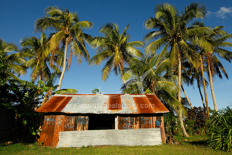 """Fayaoue village on the Ouvea island in the Loyalty islands..Ouvéa (local pronunciation: [u've.a]) is a commune in the Loyalty Islands Province of New Caledonia, an overseas territory of France in the Pacific Ocean. The settlement of Fayaoué [fa'jawe], on Ouvéa Island, is the administrative centre of the commune of Ouvéa..Ouvéa is made up of Ouvéa Island, the smaller Mouli Island and Faiava Island, and several islets around these three islands. All these lie among the Loyalty Islands, to the northeast of New Caledonia's mainland..Ouvéa Island is one of the Loyalty Islands, in the archipelago of New Caledonia, an overseas territory of France in the Pacific Ocean. The island is part of the commune (municipality) of Ouvéa, in the Islands Province of New Caledonia..The crescent-shaped island, which belongs to a larger atoll, is 50 km (30 miles) long and 7 km (4.5 miles) wide. It lies northeast of Grande Terre, New Caledonia's mainland..Ouvéa is home to around 3,000 people that are organized into tribes divided into Polenesian, Melanesian and Walisian by ethnic descend. The Iaai language is spoken on the island..The two native languages of Ouvéa are the Melanesian Iaai and the Polynesian Faga Uvea, which is the only Polynesian language that has taken root in New Caledonia. Speakers of Faga Uvea have fully integrated into the Kanak society, and consider themselves Kanak..Ouvéa has rich marine resources and is home to many sea turtles, species of fish, coral as well as a native parrot, the Uvea Parakeet, that can only be found on the island of Ouvéa..A large crustacaen called a """"coconut crab"""" or crabe de cocotier can also be found on the islands. The large crabs live in palm tree plantations and live solely on a diet of coconuts that they crack open with their powerful claws. They are blue in colour and can grow to several kilos in size. They are a land based species and do not venture into the ocean..Ouvéa is also home to trophy Bonefish that inhabit the nutrient rich """"fla"""