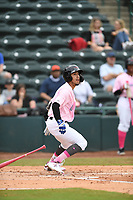 Hickory Crawdads shortstop Jonathan Ornelas (3) connects on a pitch and takes off for first base during the game with the Charleston Riverdogs at L.P. Frans Stadium on May 12, 2019 in Hickory, North Carolina.  The Riverdogs defeated the Crawdads 13-5. (Tracy Proffitt/Four Seam Images)