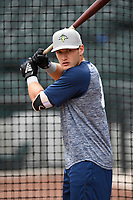Catcher Hayden Senger (15) of the Columbia Fireflies works a bunting drill before a game against the Charleston RiverDogs on Friday, April 5, 2019, at Segra Park in Columbia, South Carolina. Charleston won, 6-1. (Tom Priddy/Four Seam Images)