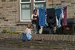 Family clean clothes laundry hanging out to dry Yorkshire  England 2010s, 2018 UK