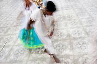 Candomblé followers dance during an Afro-Brazilian religious ritual in the temple (terreiro) in São João de Manguinhos, Bahia, Brazil, 9 February 2012.