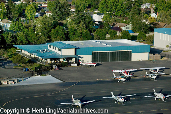First business building constructed at the Petaluma Municipal Airport, Petaluma, Sonoma County, California.  Aeroventure, which provides aircraft maintenance services and flight training, the 29ner Diner and other businesses are based in the building.