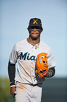 Salt River Rafters center fielder Monte Harrison (4), of the Miami Marlins organization, jogs off the field between innings of the Arizona Fall League Championship Game against the Peoria Javelinas at Scottsdale Stadium on November 17, 2018 in Scottsdale, Arizona. Peoria defeated Salt River 3-2 in 10 innings. (Zachary Lucy/Four Seam Images)