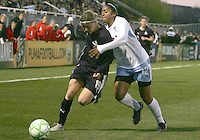 Rebecca Moros #19 of the Washington Freedom is held up by Chioma Igwe #12 of the Chicago Red Stars during a WPS match at Maryland Soccerplex on April 11 2009, in Boyd's, Maryland. The game ended in a 1-1 tie