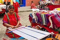 Oaxaca, Mexico, North America.  Zapotec Indian Weaver, Outdoor Market, Plazuela Labastida, near the Church of Santo Domingo.