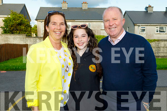 Sophie O'Connor graduating from Gaelscoil Mhic Easmainn NS on Thursday standing with her parents Una and Con O'Connor.