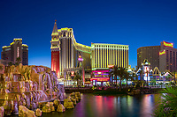 Dusk panorama on the Venice, Harrah's, and Palazzo Strip hotels, with The Mirage hotel cascades in the foreground, Las Vegas Nevada