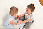 Two baby boys ages 6 and 7 months interacting