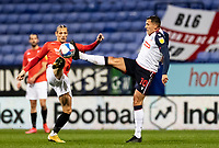 Bolton Wanderers' Antoni Sarcevic (right) competing with Salford City's Oscar Threlkeld<br /> <br /> Photographer Andrew Kearns/CameraSport<br /> <br /> The EFL Sky Bet League Two - Bolton Wanderers v Salford City - Friday 13th November 2020 - University of Bolton Stadium - Bolton<br /> <br /> World Copyright © 2020 CameraSport. All rights reserved. 43 Linden Ave. Countesthorpe. Leicester. England. LE8 5PG - Tel: +44 (0) 116 277 4147 - admin@camerasport.com - www.camerasport.com