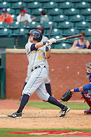 Taylor Motter (10) of the Montgomery Biscuits follows through on his swing against the Chattanooga Lookouts at AT&T Field on July 23, 2014 in Chattanooga, Tennessee.  The Lookouts defeated the Biscuits 6-5. (Brian Westerholt/Four Seam Images)