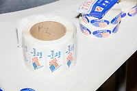 """I voted"" stickers, which also say ""Yo Vote,"" lay on a table at the School without Walls High School Ward 2 polling location in the Foggy Bottom area of Washington, D.C., on Election Day, Tue., Nov. 3, 2020. Poll workers said that the polling location was pretty quiet most of the day due to substantial mail-in voting done in DC."