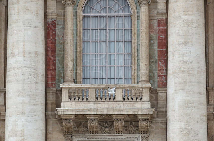 A seagull passes in front of the window of the main balcony of St. Peter's basilica where the Pope usually speaks at the Vatican on December 25, 2020, during a live-streamed Urbi et Orbi blessing organised inside the Vatican Blessing hall amid the Covid-19 pandemic.<br /> UPDATE IMAGES PRESS/Isabella Bonotto<br /> <br /> STRICTLY ONLY FOR EDITORIAL USE