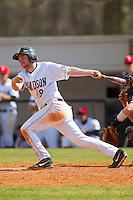 David Daniels (8) of the Davidson Wildcats follows through on his swing against the Western Carolina Catamounts at Wilson Field on March 10, 2013 in Davidson, North Carolina.  The Catamounts defeated the Wildcats 5-2.  (Brian Westerholt/Four Seam Images)